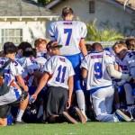 Tyger Goslin leading team in prayer